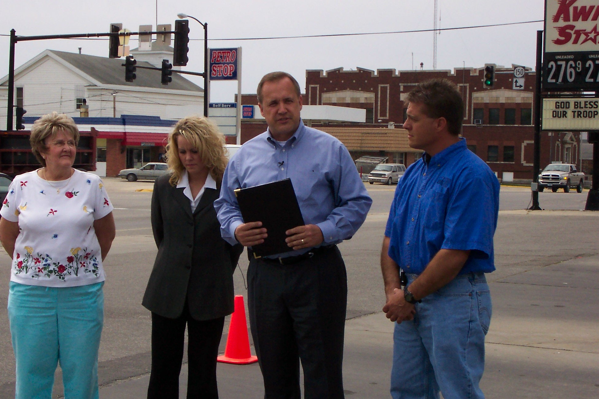 Jim unveils new energy legislation at a gas station in Independence.