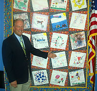 Congressman Radanovich admires the quilt made by Linda Smittcamp of Clovis. The quilt helped raise money for Children's Hospital Central California and is now on display in the Congressman's DC office
