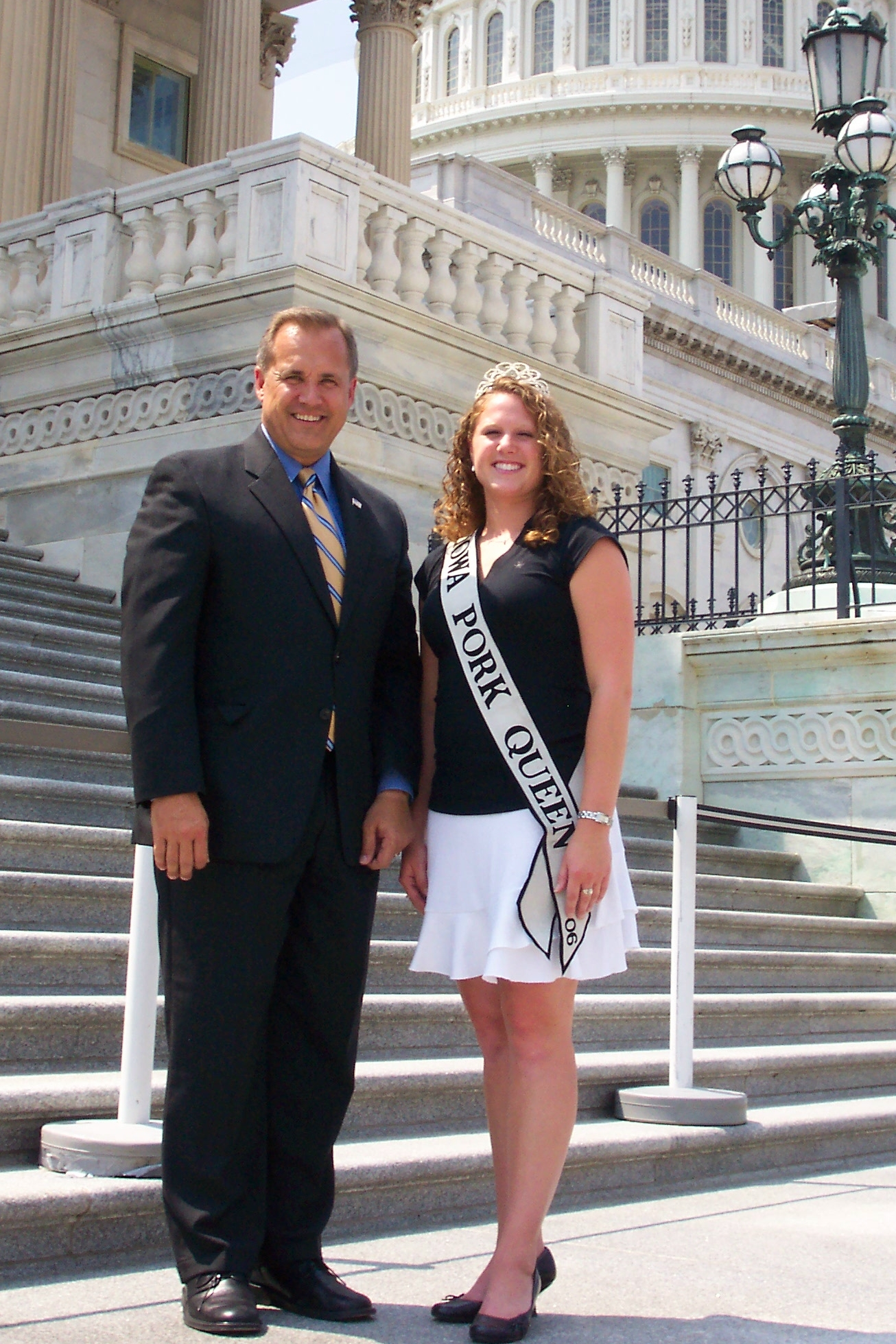 Jim with Iowa Pork Queen, Amber Appleton, on the steps of the United States Capitol.