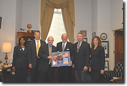 Photo (L to R):  Space Shuttle Discovery Mission Specialist Stephanie Wilson, Mission Specialist Piers Sellers, Pilot Mark Kelly, U.S. Rep. Sherwood Boehlert (NY-24), Mission Specialist Mike Fossum and Mission Specialist Lisa Nowak