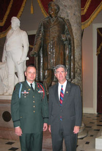 Photo - Rep. Miller invites Lt. Benjamin Wynn of Raleigh, an Iraq War vet from North Carolina's Army National Guard, to attend the speech of Iraqi Prime Minister Dr. Nouri al-Maliki to a Joint Meeting of Congress. The two are standing in the Capitol's National Statuary Hall near the bronze statue of Senator Zebulon Vance, who was a former NC governor and US representative.