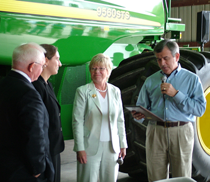 Pryce pictured with Secretary Mike Johanns and rural business leaders