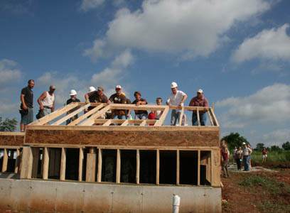 Congressman Roy Blunt lends a helping hand with the Habitat for Humanity group to build a home for a woman and her son.