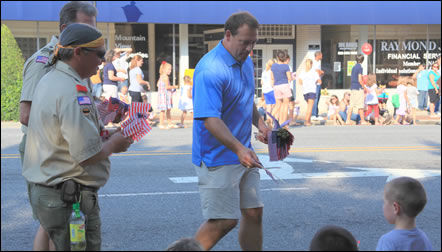 Congressman Shuler marches in the Marion 4th of July parade