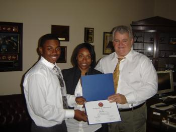 Congressman Brady presents an award to the 2009 Congressional Arts Competition winner.