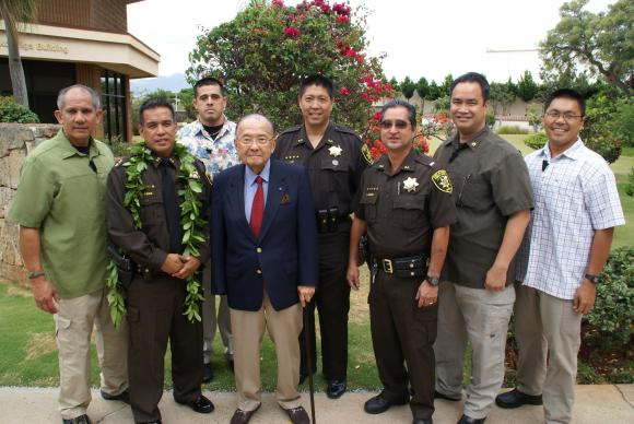 Senator Inouye attends a ceremony for new Hawaii Deputy Sheriff recruits.