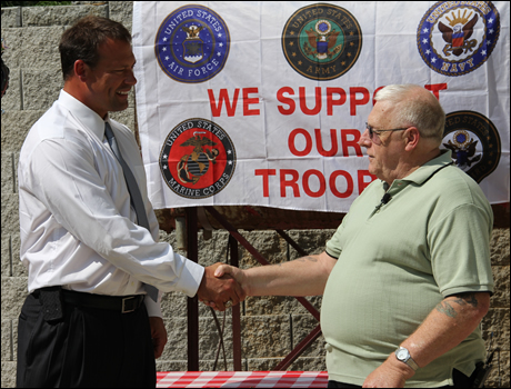 Rep. Shuler presents long-overdue medals and awards to Waynesville veteran David Gifford.