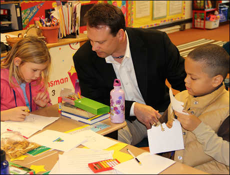 Congressman Shuler makes holiday cards for the troops with third graders at Glen Arden Elementary.