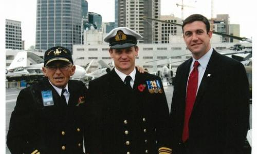 Congressman Hunter stands with fellow veterans after a ceremony aboard the U.S.S. Midway in San Diego feature image