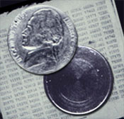 Photograph of hollow nickel and message it contained.